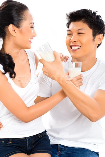 Asian Chinese couple drinking milk living healthy Stock photo © Kzenon
