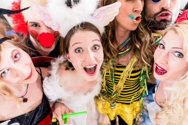 Women and men celebrating at party Stock photo © Kzenon