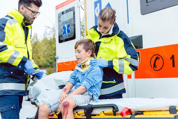 Emergency medics taking care of injured boy Stock photo © Kzenon