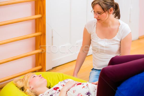 Midwife giving prenatal care for pregnant mother Stock photo © Kzenon
