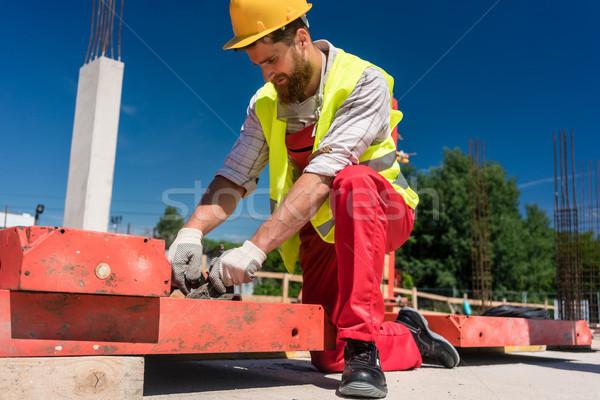 Worker installing metallic framing Stock photo © Kzenon