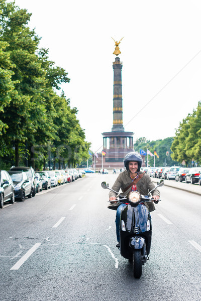 Tourist in Berlin riding scooter Stock photo © Kzenon