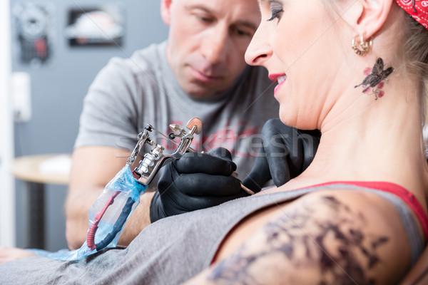 Trendi nő mosolyog új tetoválás oldalnézet közelkép Stock fotó © Kzenon