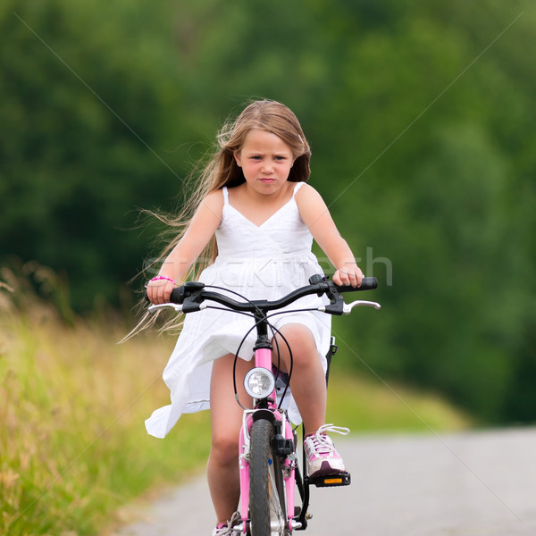 Child cycling outdoors in summer Stock photo © Kzenon