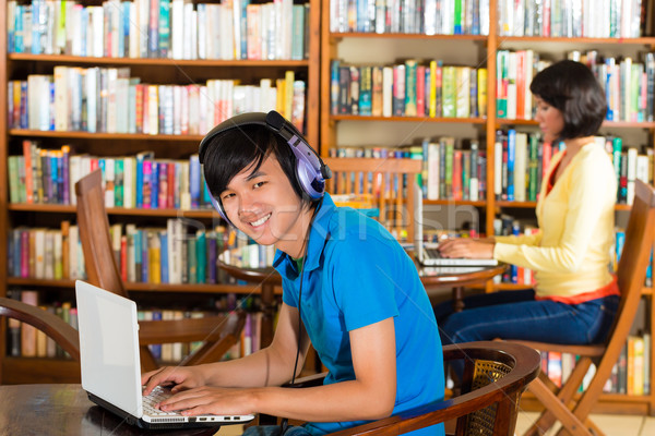 Stock photo: Student in library with laptop