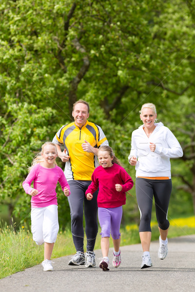 Family jogging for sport outdoors Stock photo © Kzenon
