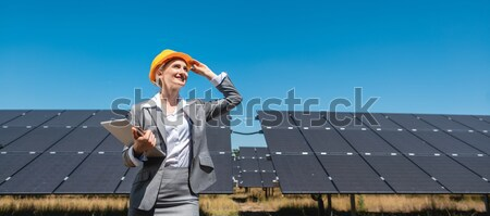 Solar panels with blue sky, architect in front Stock photo © Kzenon