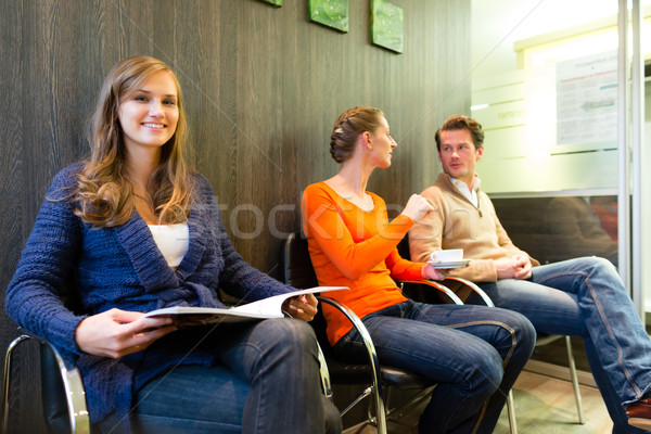 Patients in the waiting room of a doctors office Stock photo © Kzenon
