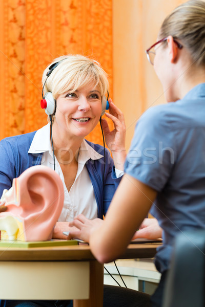 Deaf woman takes a hearing test Stock photo © Kzenon
