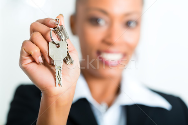 Young realtor with keys in an apartment Stock photo © Kzenon