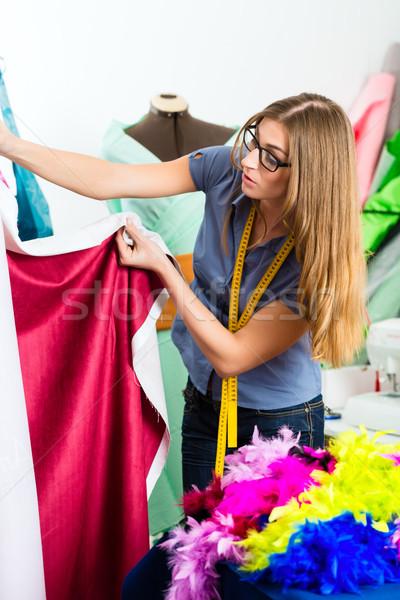Fashion designer or tailor working in studio Stock photo © Kzenon