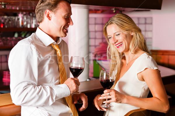 Casual Businesspeople flirting in hotel bar Stock photo © Kzenon