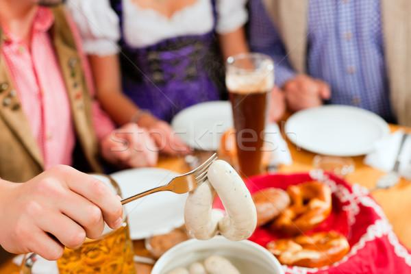 朝食 白 子牛肉 ソーセージ グループ 若い男性 ストックフォト © Kzenon