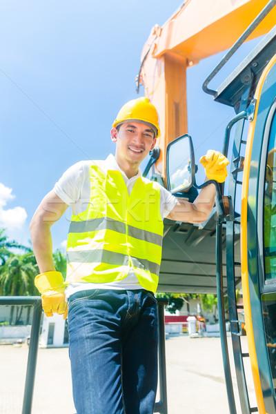 Foto stock: Asia · constructor · excavadora · conductor · pie