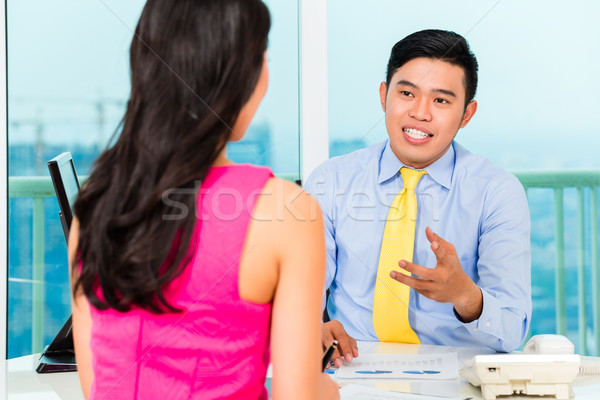Asian advisor with client on financial investment Stock photo © Kzenon