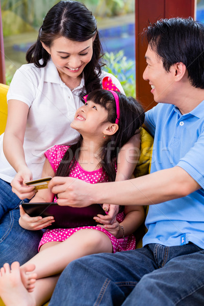 Chinese family online shopping with tablet computer Stock photo © Kzenon