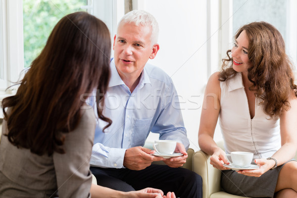Advisor giving investment advice to senior couple Stock photo © Kzenon
