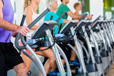Woman and men being motivated for fitness and sport Stock photo © Kzenon