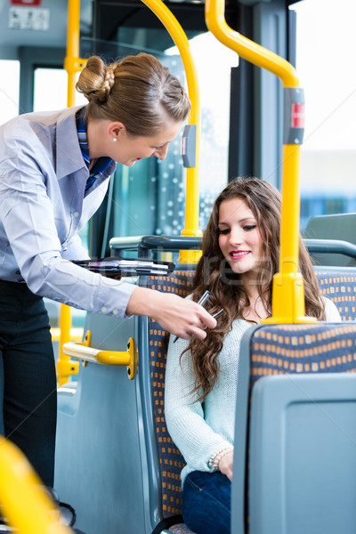 Woman in bus having no valid ticket at inspection Stock photo © Kzenon
