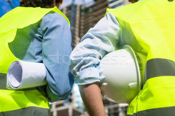 Civil engineers visiting building site Stock photo © Kzenon