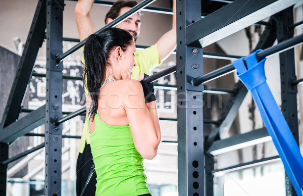 Women and man training in cage for better fitness Stock photo © Kzenon