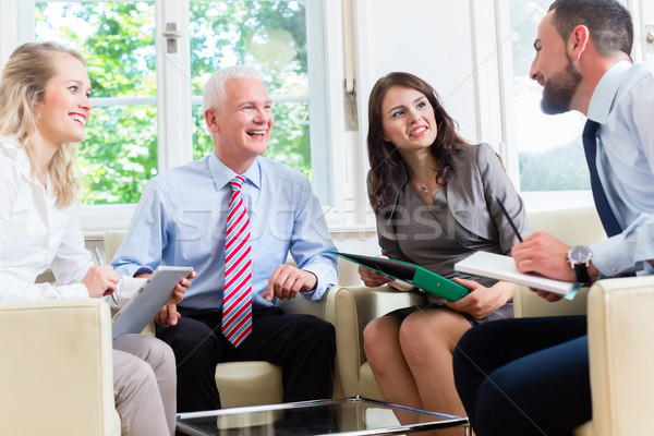 Businesspeople having discussion in office Stock photo © Kzenon