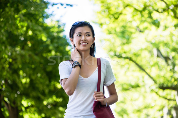 Serene young woman walking in the park Stock photo © Kzenon