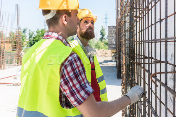 Two workers checking the durability of the steel structure Stock photo © Kzenon