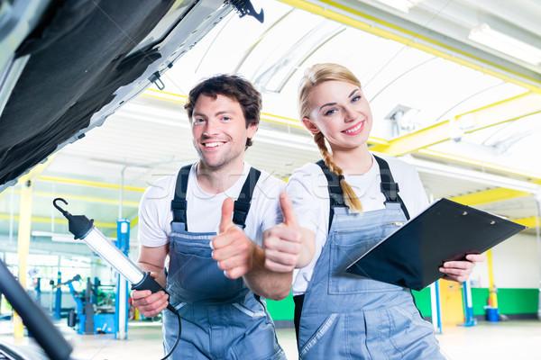 Mechanic team working in car workshop Stock photo © Kzenon