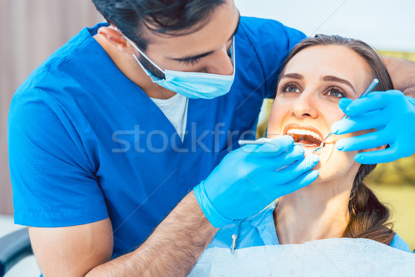 Beautiful woman looking with confidence at her reliable dentist  Stock photo © Kzenon