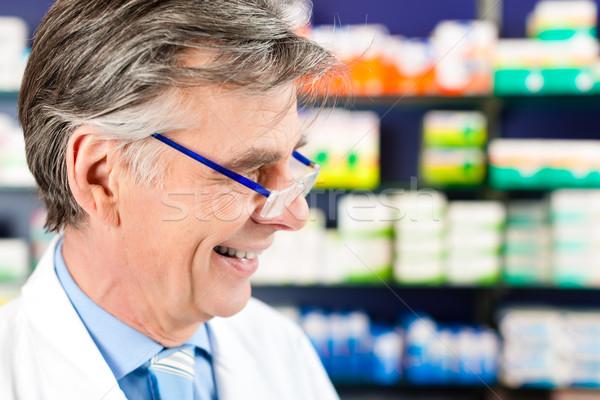 Pharmacist in pharmacy Stock photo © Kzenon