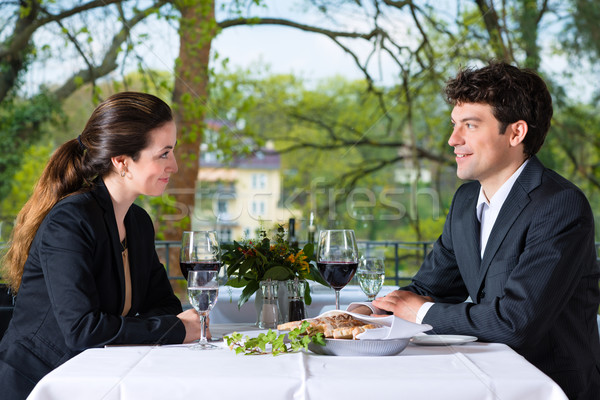 Businesspeople having lunch in restaurant Stock photo © Kzenon