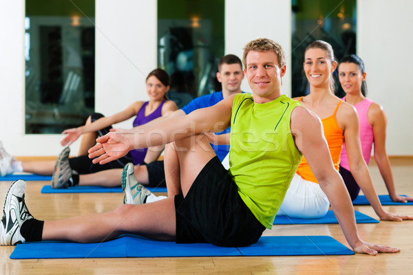 Stretching in fitness club Stock photo © Kzenon