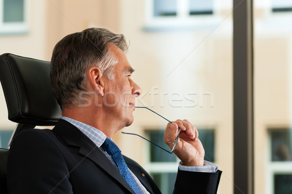 Business - Boss contemplating in his office Stock photo © Kzenon