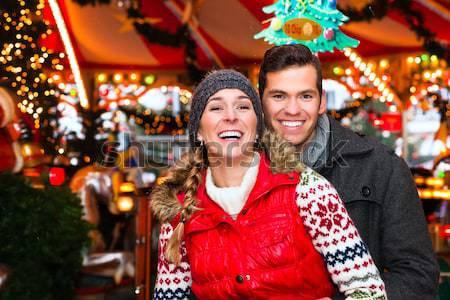 Couple drinking spiced wine on Christmas market Stock photo © Kzenon