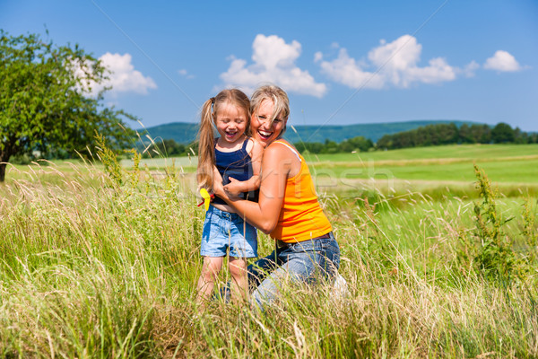 Mother and Daughter in summer on meadow Stock photo © Kzenon