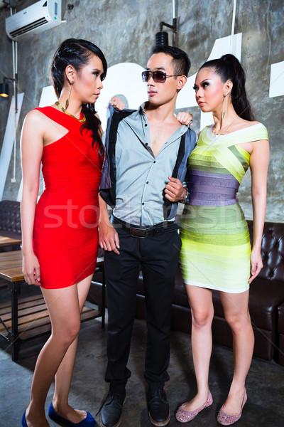 Kıskanç Asya kadın kavga adam gece kulübü Stok fotoğraf © Kzenon