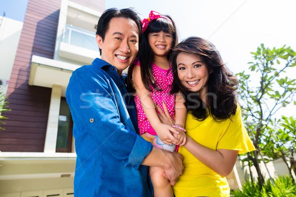 Asian family with child standing in front of home Stock photo © Kzenon