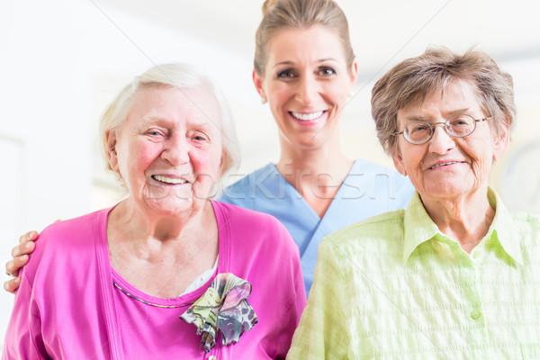 Elderly care nurse with two senior women Stock photo © Kzenon