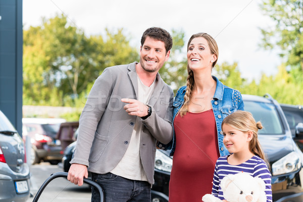 Mother, father, and child buying car at dealership Stock photo © Kzenon