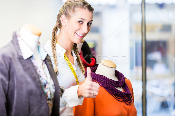 Small business owner dressing shop window Stock photo © Kzenon