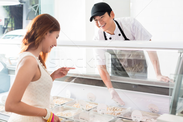 Smiling young worker assisting a customer Stock photo © Kzenon