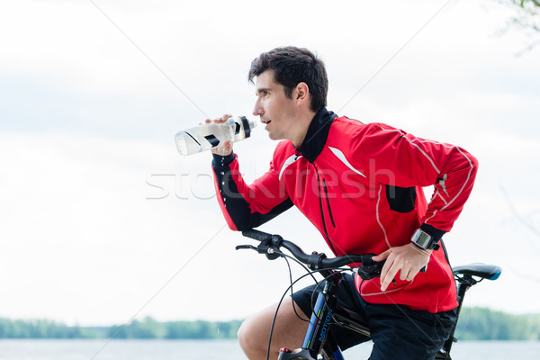 Sport man mountainbike drinkwater gelukkig fitness Stockfoto © Kzenon