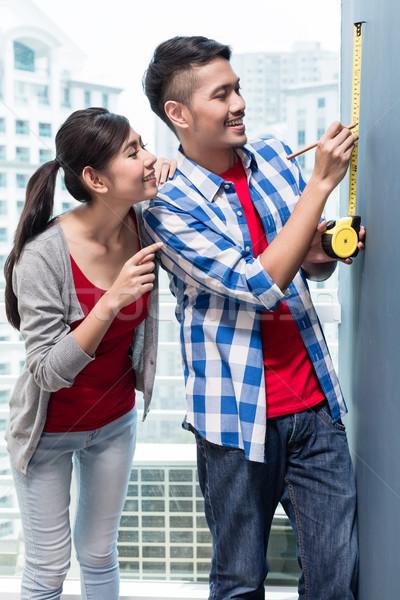 молодые индонезийский пару стен новых Сток-фото © Kzenon
