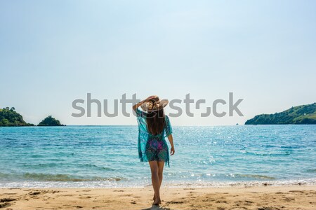 Young fit woman standing on a tropical beach in the summer vacation Stock photo © Kzenon