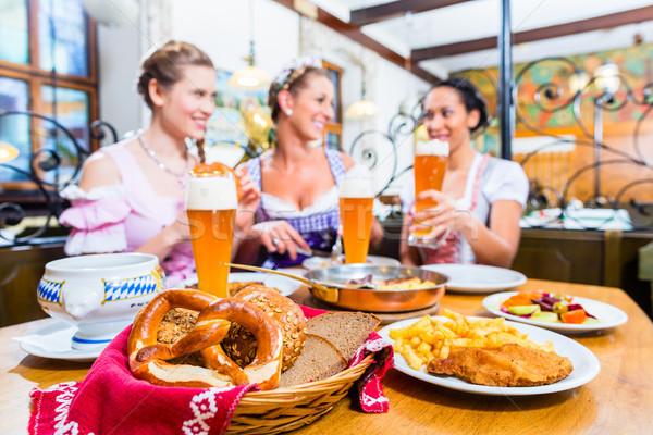 Women eating lunch in Bavarian Restaurant Stock photo © Kzenon