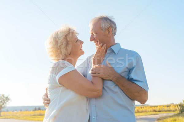 Romantic elderly couple enjoying health and nature in a sunny day Stock photo © Kzenon