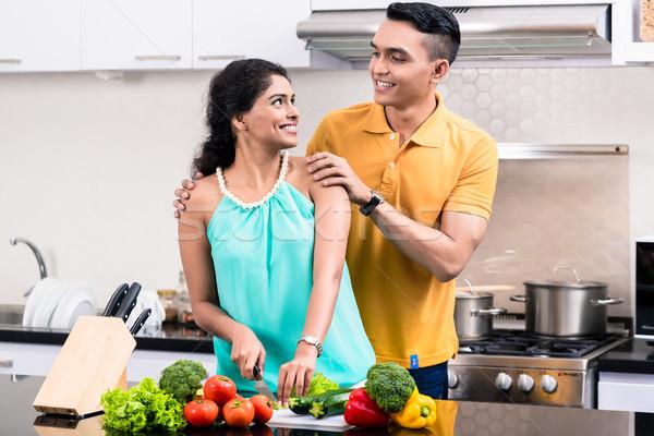 Fiatal mosolyog pár konyha néz egyéb Stock fotó © Kzenon
