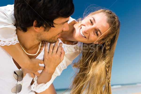 Couple enjoying freedom on the beach Stock photo © Kzenon