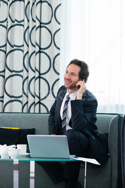 businessman in hotel is on the phone Stock photo © Kzenon